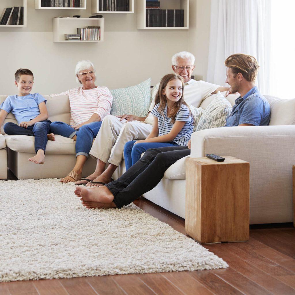 Family gosping in living room | Barrett Floors